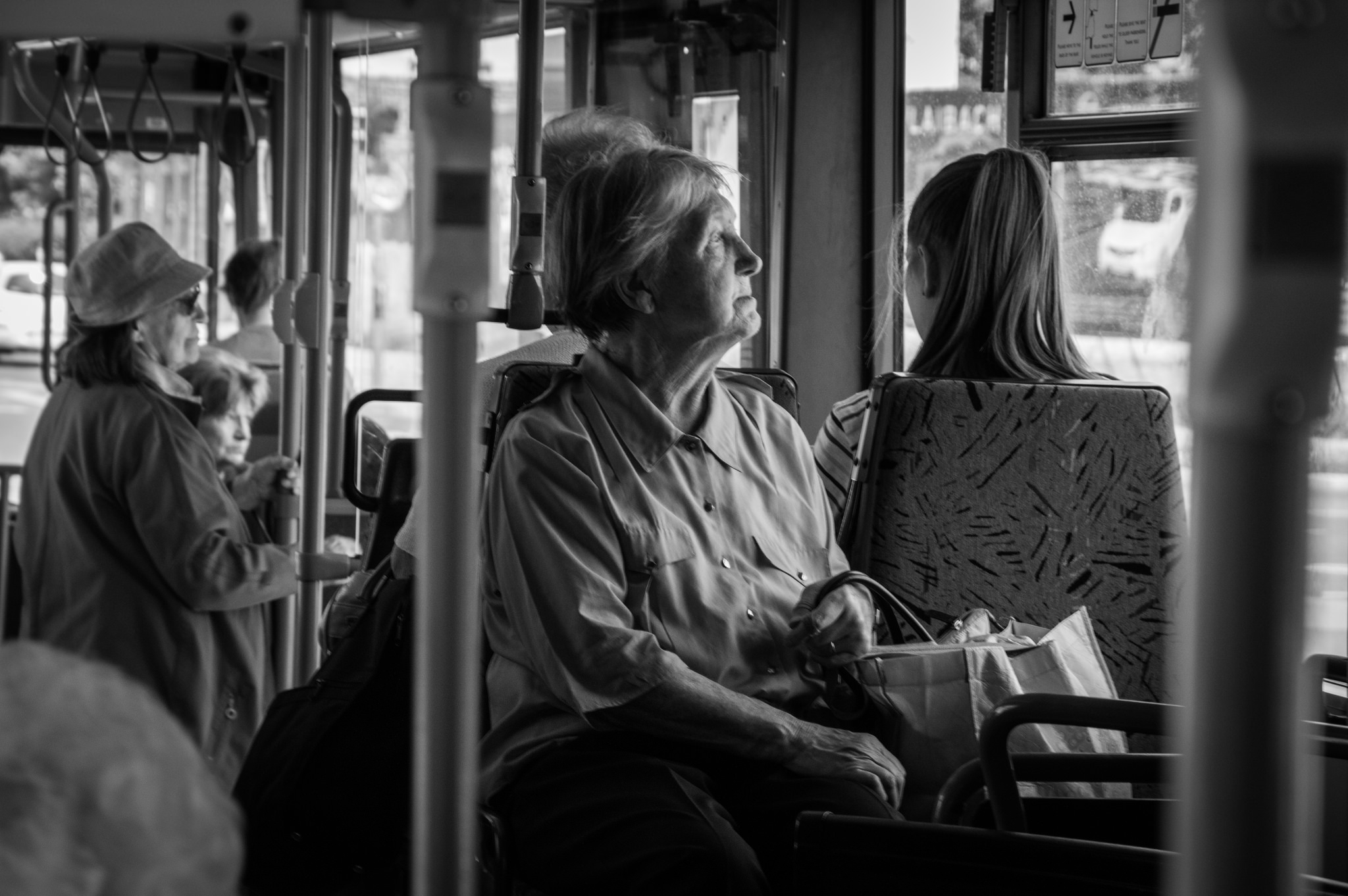 Older person on bus - portrait