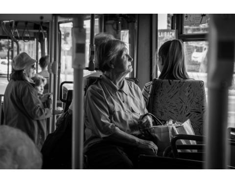 Older person on bus - portrait