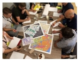 People discussing and planning over the maps