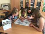 Kids drawing the map and discussing